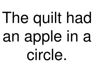 The quilt had an apple in a circle.