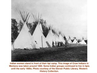Indian women stand in front of their tipi camp. This image of Crow ...