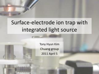 Surface-electrode ion trap with integrated light source