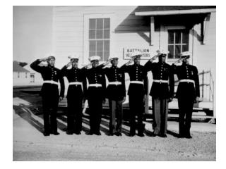 """Steward's mates joke as they dry silverware in the wardroom of U.S.S. Ticonderoga (CV-14)."""