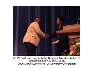Dr. Michael Harris accepts the Dreamer Award on behalf of recipient Dr. Mark J. Smith at the