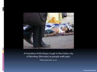 A homeless child sleeps rough in the Indian city of Bombay (Mumbai) as people walk past .