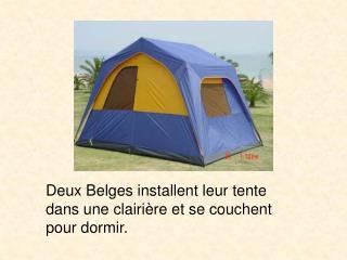 Deux Belges�installent leur tente dans une clairi�re et se couchent pour dormir.