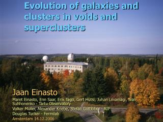 Evolution of galaxies and clusters in voids and superclusters