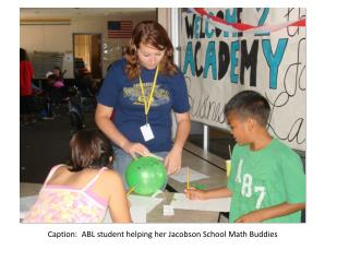 Caption:  ABL student helping her Jacobson School Math Buddies