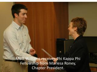 Matt Williams receives Phi Kappa Phi Fellowship from Marlesa Roney, Chapter President.