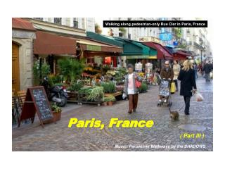 Walking along pedestrian-only Rue Cler in Paris, France