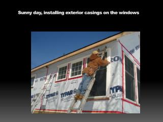 Sunny day, installing exterior casings on the windows