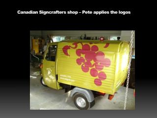 Canadian  Signcrafters  shop – Pete applies the logos