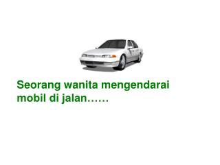 Seorang wanita mengendarai mobil di jalan……