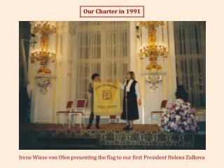 Irene Wiese von Ofen presenting the flag to our first President Helena Zidkova