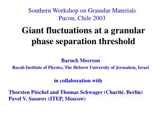 Giant fluctuations at a granular phase separation threshold