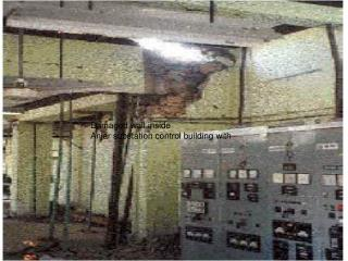 Damaged wall inside Anjar substation control building with