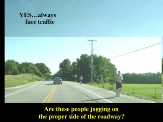 Are these people jogging on  the proper side of the roadway?