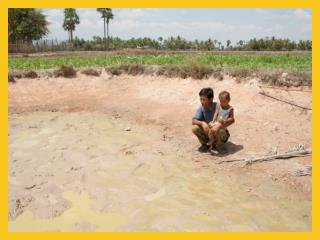 Pastor Chheoun  manages the rice bank  for the community.