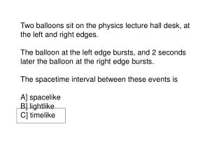 Two balloons sit on the physics lecture hall desk, at the left and right edges.