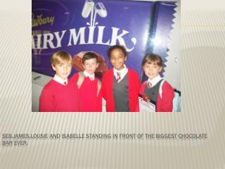Seb,james,lousie and Isabelle standing in front of the biggest chocolate bar ever.