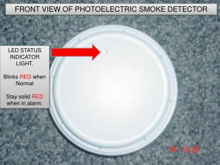 How does a photoelectric smoke detector work?