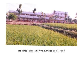 The school, as seen from the cultivated lands, nearby