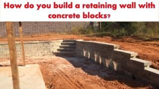 How do you build a retaining wall with concrete blocks?