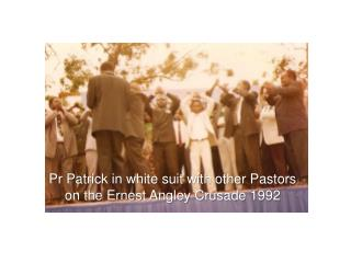 Pr Patrick in white suit with other Pastors on the Ernest Angley Crusade 1992