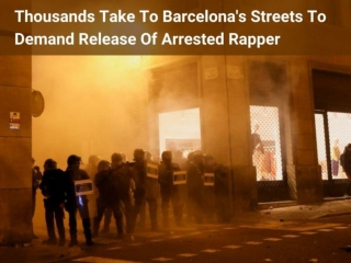 Thousands take to Barcelona's streets to demand release of arrested rapper
