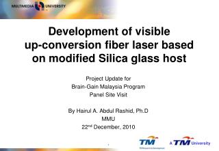 Development of visible  up-conversion fiber laser based on modified Silica glass host