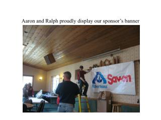 Aaron and Ralph proudly display our sponsor's banner