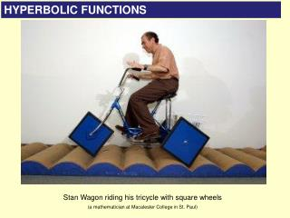 Stan Wagon riding his tricycle with square wheels