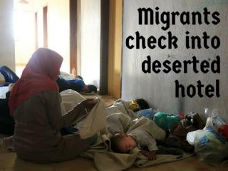 Migrants check into deserted hotel